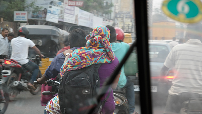 Head covering took on a practical application when coupled with the dense exhaust from vehicles driven by Hyderabad, India's 7+ million people.
